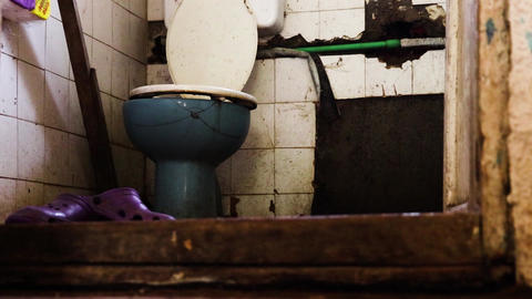 Dirty and abandoned home toilet GIF