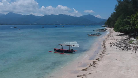 flying over a fishing boat in sunny weather gili islands Live Action