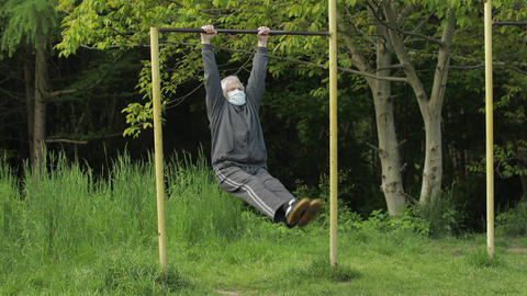 Active senior old man do stretching physical exercises in coronavirus quarantine Live Action