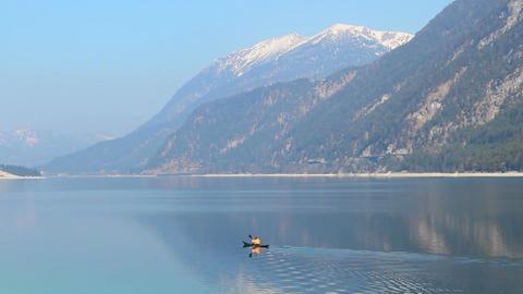 Man canoeing on mountain lake, enjoying beautiful nature, solitude, recreation Footage