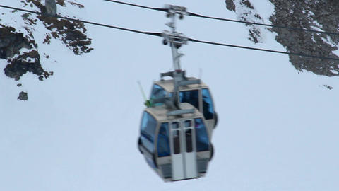 Cableway cabins moving fast, transporting skiers and snowboarders to skiing run Footage