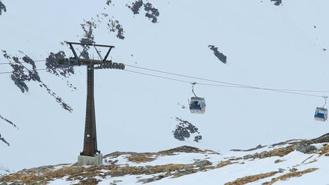 Modern cable cars moving tourists up and down in snowy mountains, ski resort Footage