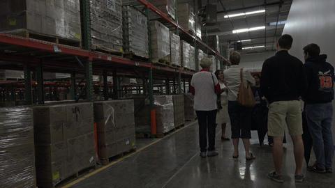 Mormon missionaries tour Welfare Square storehouse 4K 004 Footage