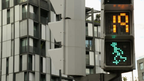 Traffic light timer counting down seconds for pedestrians to cross the street Footage