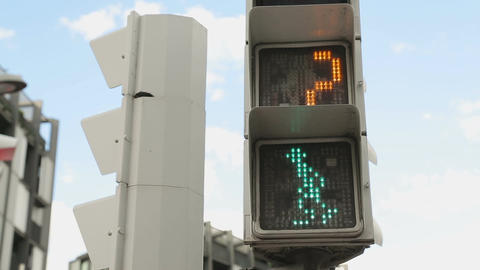Crossroad light switches to red, people not allowed to walk, traffic rules Footage