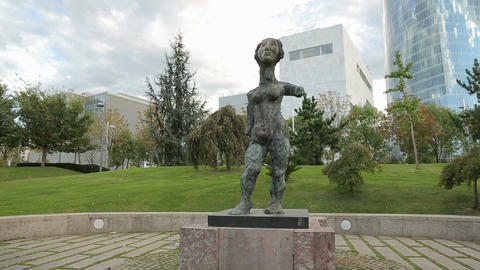 Strange female statue exhibited in the park in front of modern business center Footage