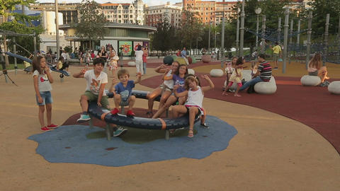 Many children waving hands in camera, hanging out and having fun on playground Footage