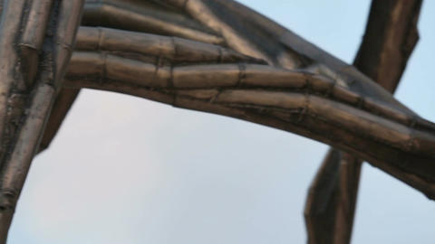 Horizontal panorama of modern bronze sculpture, detailed view of metal parts Footage