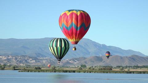 Mountain valley lake hot air balloons flight 4K Footage