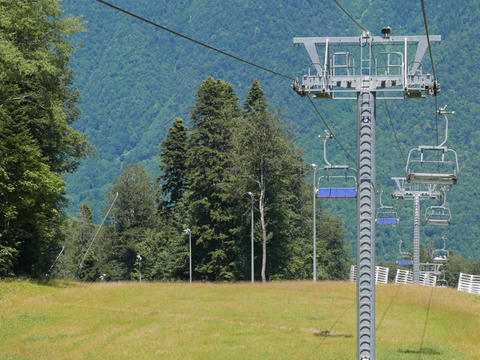Chair lift above ski slope. Sochi, Russia Footage