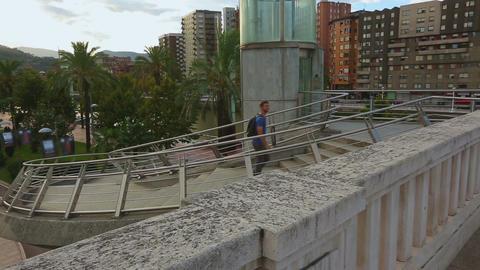 Male traveler walking around, checking out landmarks in modern city district Footage