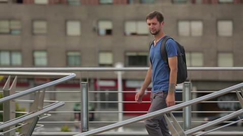 Young happy man enjoying his walk in resort city, traveler on summer vacation Footage