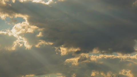 Horizontal panorama of beautiful evening sky, sun rays shining through clouds Footage