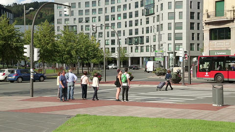 Pedestrians waiting for green traffic light to cross the road in Bilbao, Spain Footage