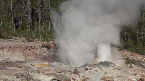 Nature Steamboat Geyser spray water steam Yellowstone 4K Footage