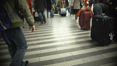 Many people walking with luggage, busy passengers at airport or railway station Footage