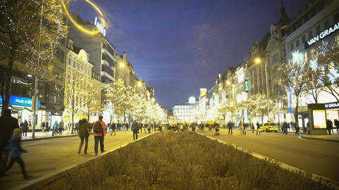 Crowded boulevard in city downtown, people enjoying evening walk in city center Footage