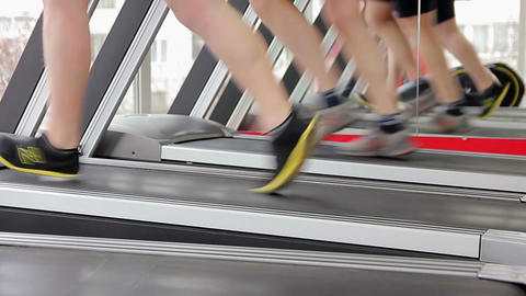 Men running on treadmill, doing toning exercises for leg muscles, healthy life Footage