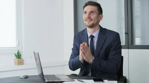 Happy and delighted young businessman in the office Footage