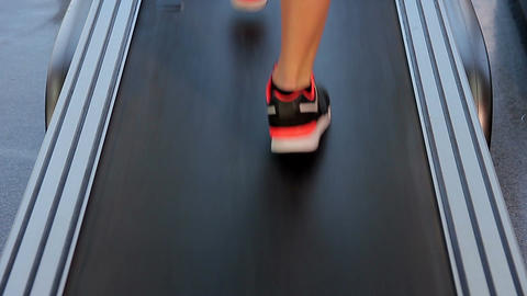 Female feet walking and running on treadmill in the gym, tough way to success Footage