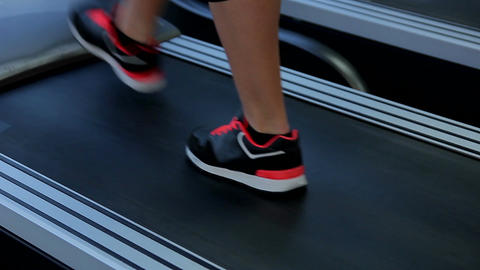 Female feet walking on treadmill. Woman completes workout routine, reaches goal Footage