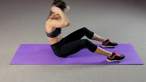 Sportive woman doing abs exercises to have flat belly, training in fitness club Footage