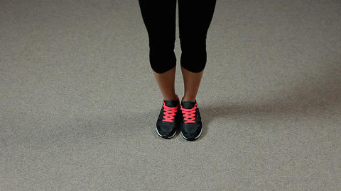 Legs of sportive woman doing jumping rope exercises in gym, healthy lifestyle Footage