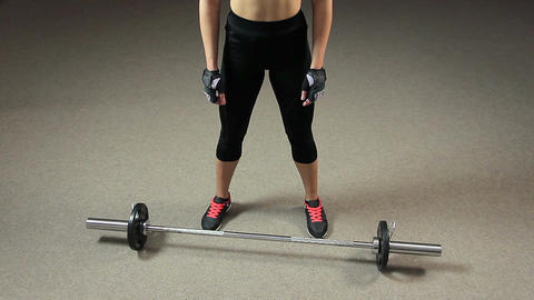 Motivated strong female athlete preparing to lift heavy barbell, weightlifting Footage