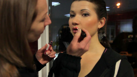 Make-up artist preparing model for fashion shoot, beauty contest backstage Footage