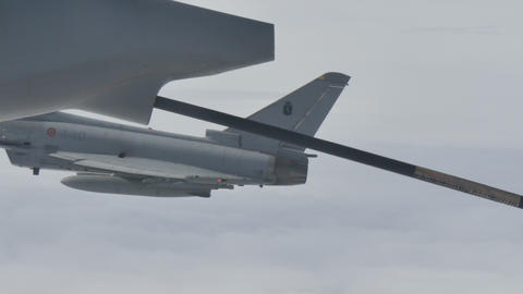Fighter Aircraft Flying in formation with Air to Air Refueling Tanker Live Action