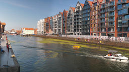 Gdansk, Poland. Newly built tenements on the right side of Motlawa river Acción en vivo