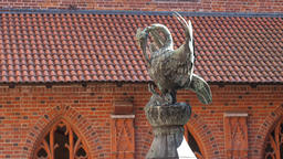 The pelican sculpture in the courtyard of the High Castle Live Action