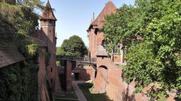 Malbork castle. Pathway (old moat) between middle and high castle Live Action