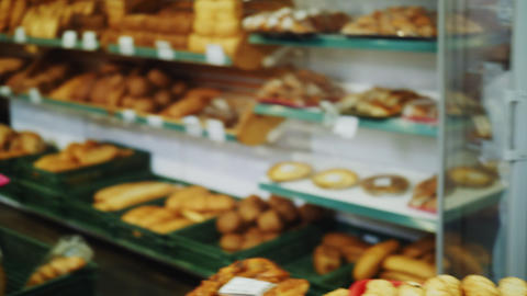 saleswoman carries tasty cakes to client choosing pastries Live Action