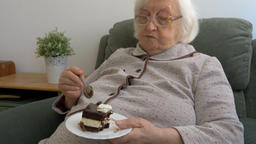 Old woman is eating cake Live Action