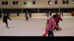 Ice skating rink. People ice skating. Defocused Live Action