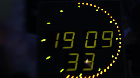 Clock display with electronic scoreboard. Close-up, Live Action