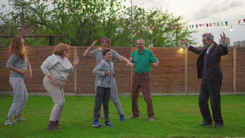 Happy family celebrating party. Dancing and enjoying celebration Live Action