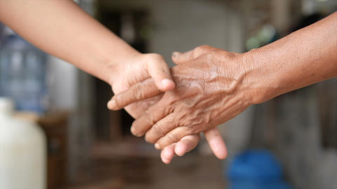 Hand of young woman and old woman be hand in hand metaphor contact commitment and promise 002 Live Action