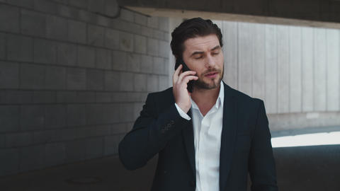 Businessman talking on cellphone at street. Business man calling on phone Live Action