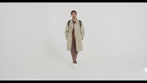 Fashion guy goes to the camera, fashionably dressed Live Action