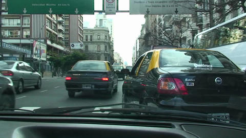 Taxi in Buenos Aires late afternoon busy street in Buenos Aires, Argentina Footage