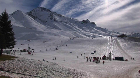 People are preparing to ski at a mountain resort Stock Video Footage