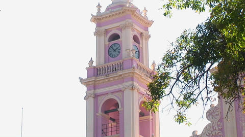 A pink clock tower displays the time Stock Video Footage
