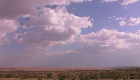 High clouds drift over grassy plains Footage