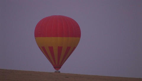 A hot air balloon rises from off the ground Stock Video Footage