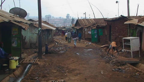 People walk down a dirty street in a shanty town Footage