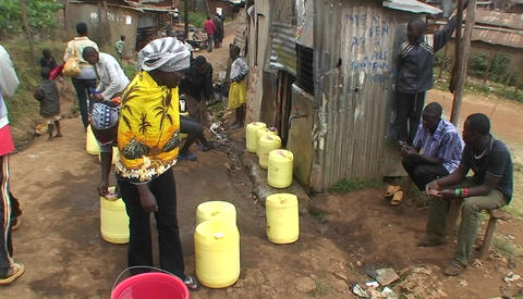 People fill water in canisters from a faucet on the street Stock Video Footage