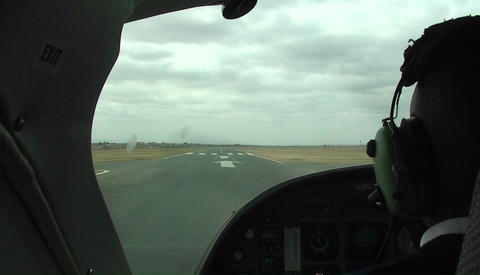 A small aircraft takes off from a runway Stock Video Footage