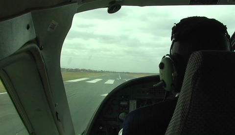 A small aircraft takes off from a runway Footage